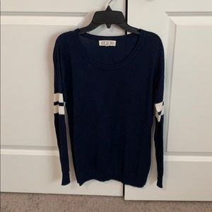 Navy thin sweater with white strips.